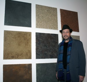 """Artist Alan Sonfist, stands next to his piece, """"Nine works from the series Earth Paintings of U.S.A."""""""