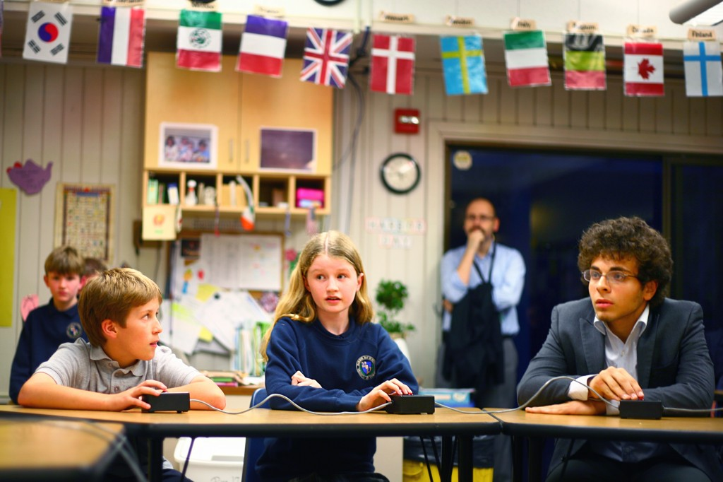 Wanlass (middle) answers a question during the first round of the competition as Ozer (right) listens. Both finished the night on top, with Ozer as regional champ and Wanlass winning the elementary division.