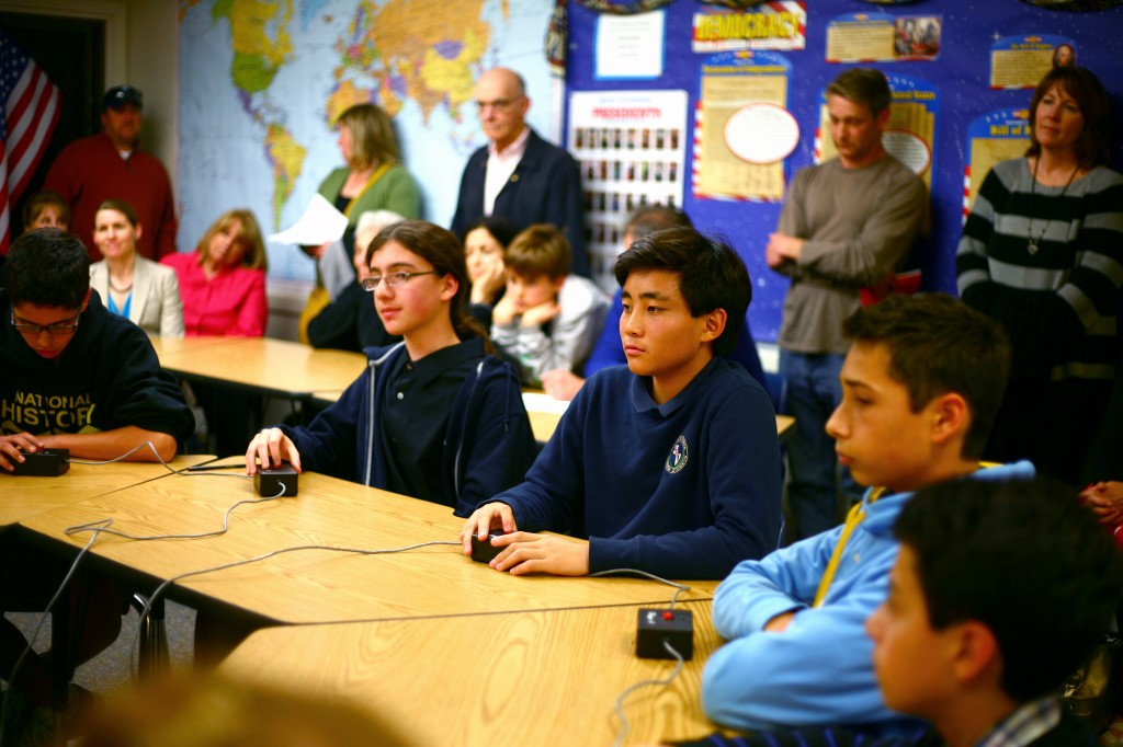 Evan Park (middle), an eighth grader at HDS, listens to a question during the first round of the Bee.