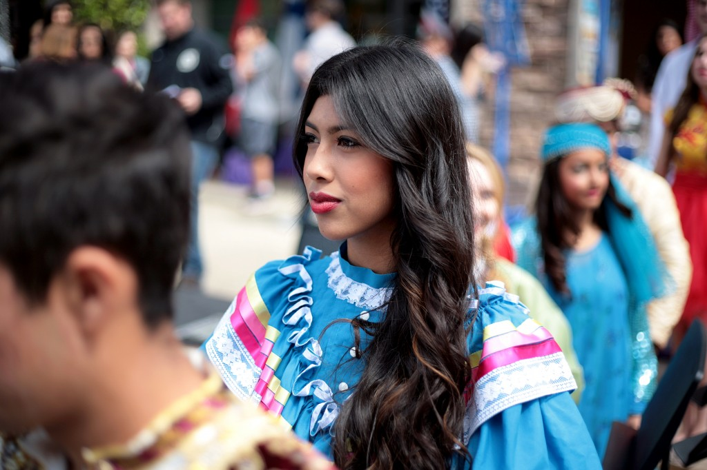 Junior Elizabeth Alvarez, 17, wearing a traditional Mexican outfit, waits to go on stage during the International Fashion Show.