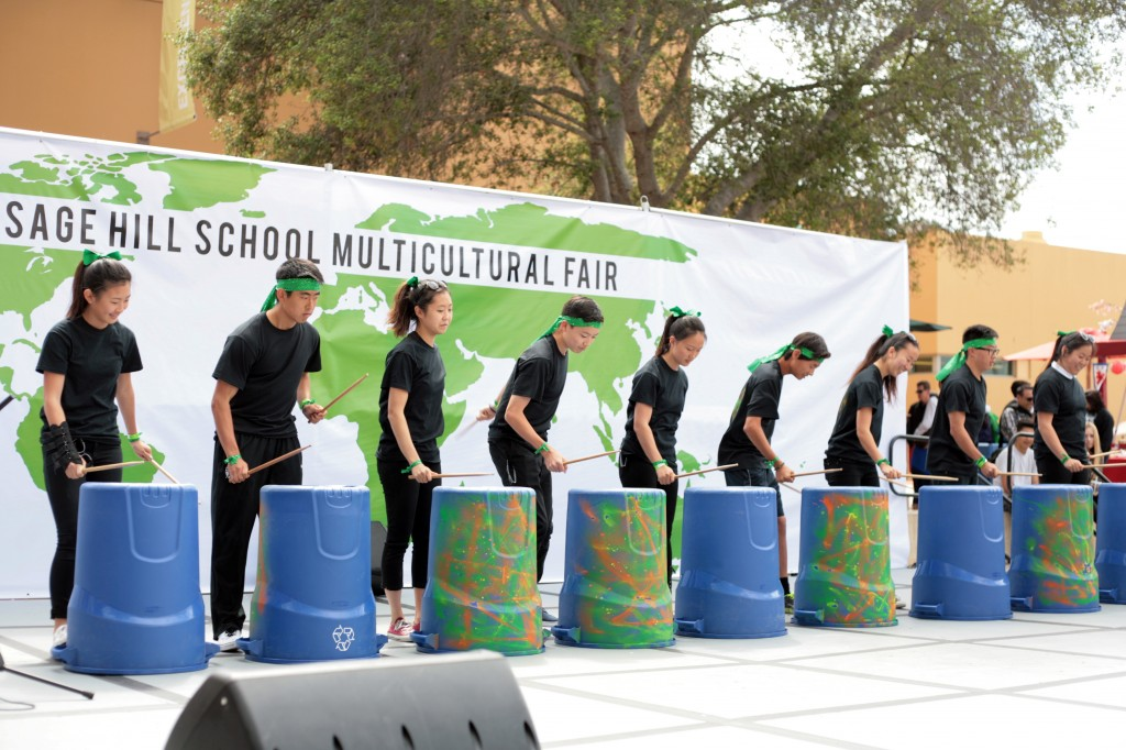 A group of Sage Hill School students perform on the Korean Nanta Drums during the school's 13th Annual Multicultural Fair on Saturday.