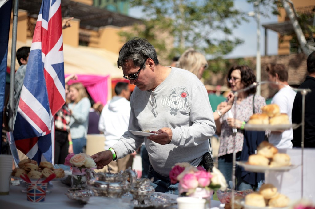 First time fair attendee Jose Hernandez of Riverside, originally from Argentina, picks out one of the homemade British scones.