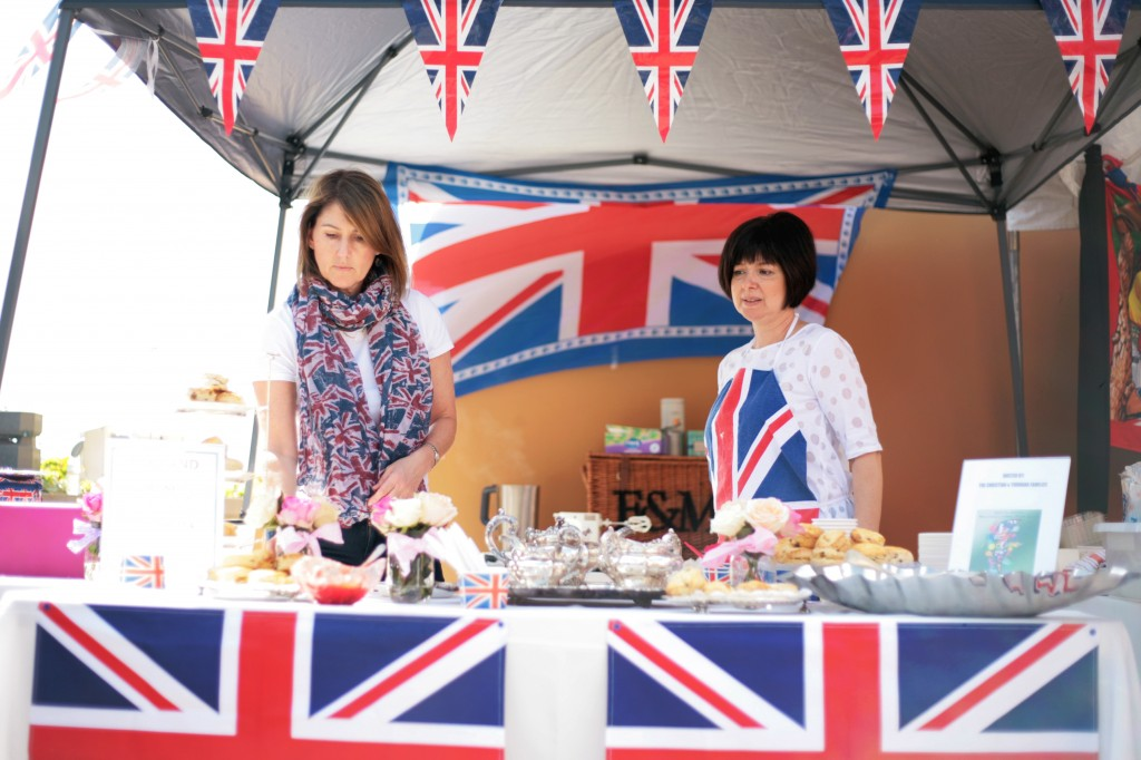 Volunteer moms Debbie Christian of Laguna Beach and Carmen Youhanna of Newport Beach work the British booth during the fair. Christian's kids, Amelia and Isabella, both 18 and both seniors, and Youhanna's kids, Helena, 16, and Michael, 18, were helping out in other parts of the event.