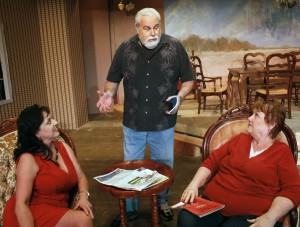 Director Brian Page (center) rehearses a scene with Della Lisi and Sharyn Case