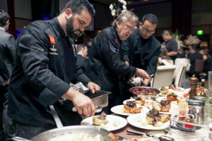 Chef Pascal Olhats (center) and his culinary team