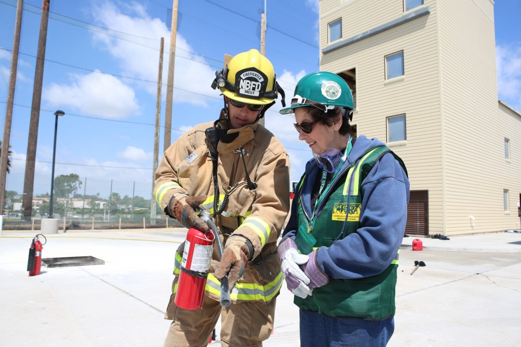 Firefighter Matt Skelly shows a CERT member how to properly use a fire extinguisher. — All photos by Jim Collins