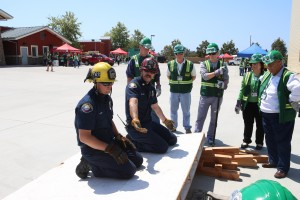 Firefighter Jim Reideler (left) and Captain Charlie Dall explain how to lift heavy objects during outdoor search and rescue.