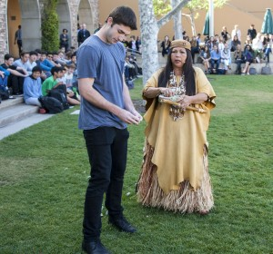 Jacque Tahuka-Nunez and student body president Jack Williamson place fresh sage leaves in a circle around the town square.  — Photo by Charles Weinberg