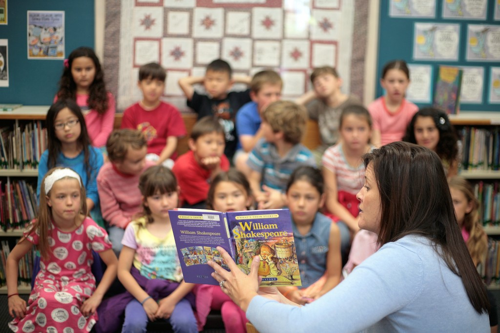 Pegasus School librarian Carin Meister reads a book about the life of William Shakespeare to a group of second graders on Wednesday. The school was celebrating the famous playwright's 450th birthday this week.