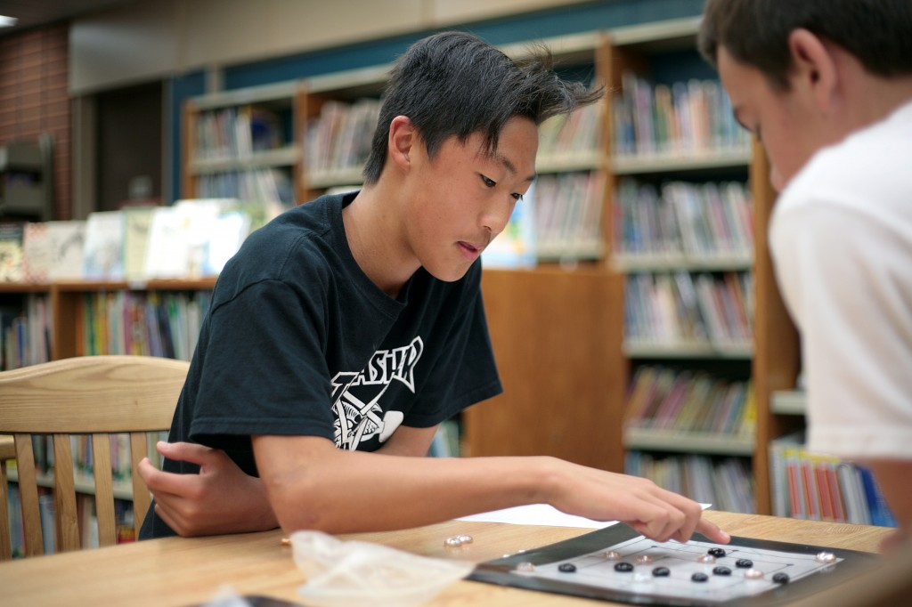 Newport Beach resident and Pegasus School eighth grader Ben Gil, 14, plays Nine Men Morris, a game popular during Shakespeare's time.