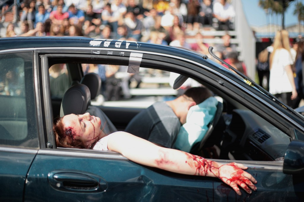 "Corona del Mar High School seniors Natalie Sullivan and Ricker Hausam act as victims in a staged DUI accident Tuesday as part of the ""Every 15 Minutes"" program."