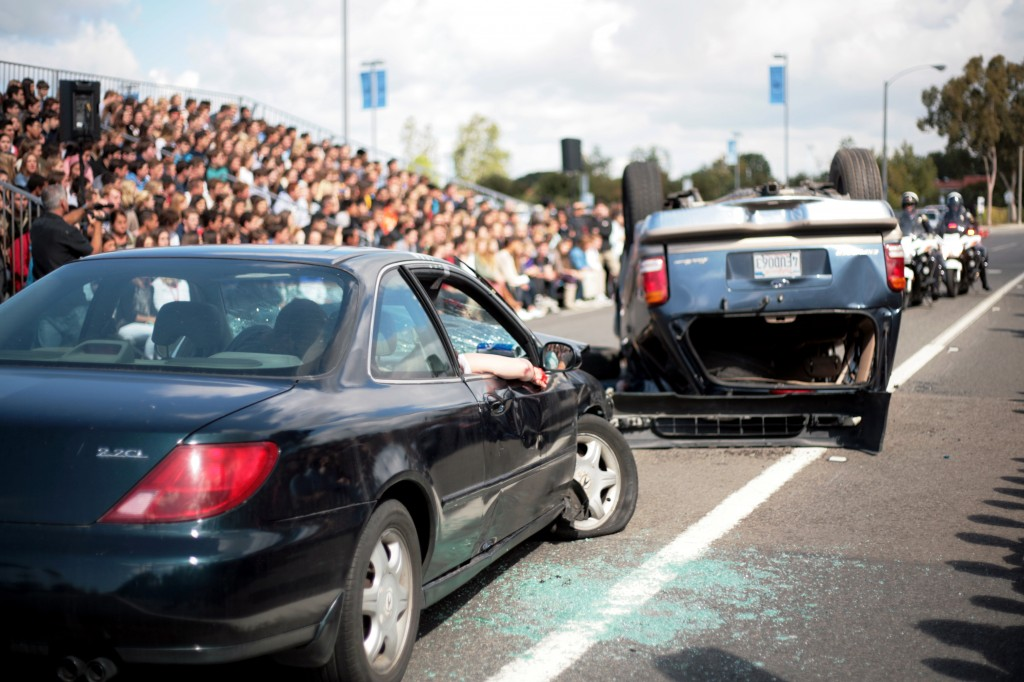 "A simulated scene of a triple fatality, two-vehicle collision unfolds in front of Corona del Mar High School students on Tuesday. The staged scene was part of ""Every 15 Minutes"" program at CdM this week"