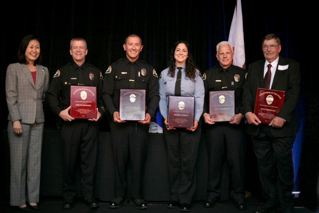 (left to right) Reserve Officer of the Year Steven Schogel, Officer of the Year Kyle Markwald, Civilian of the Year Desiree Basich, Supervisor of the Year Lloyd Whisenant, and Volunteer of the Year Stan Bressler. — Photo by Sara Hall