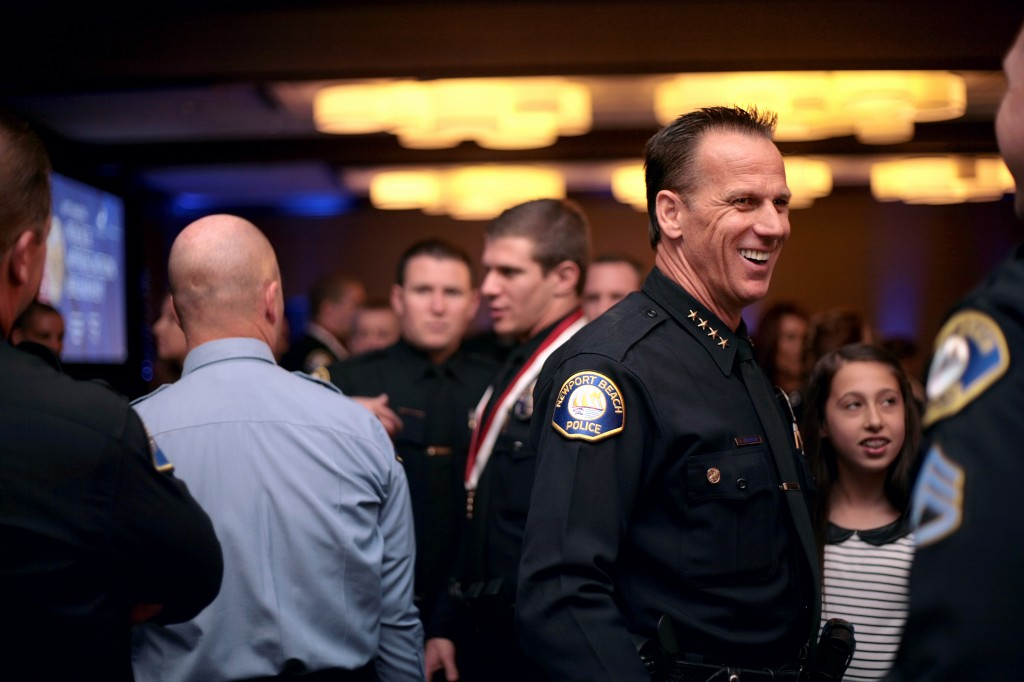 Now-retired Newport Beach Police Chief Jay Johnson chats with guests after an event in 2014. — Photo by Sara Hall ©