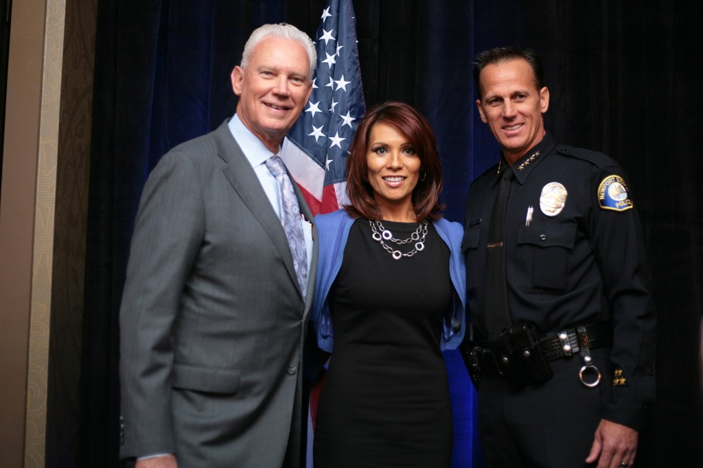 (left to right) Mayor Rush Hill, ABC7 OC Bureau Chief and event announcer Eileen Frere, and NBPD Chief Jay Johnson. — Photo by Sara Hall