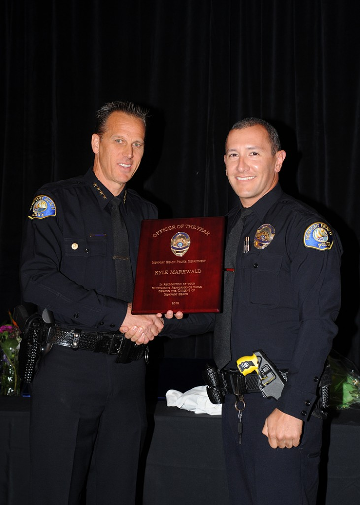 Chief Jay Johnson with Officer of the Year Kyle Markwald — Photo by Don Gage