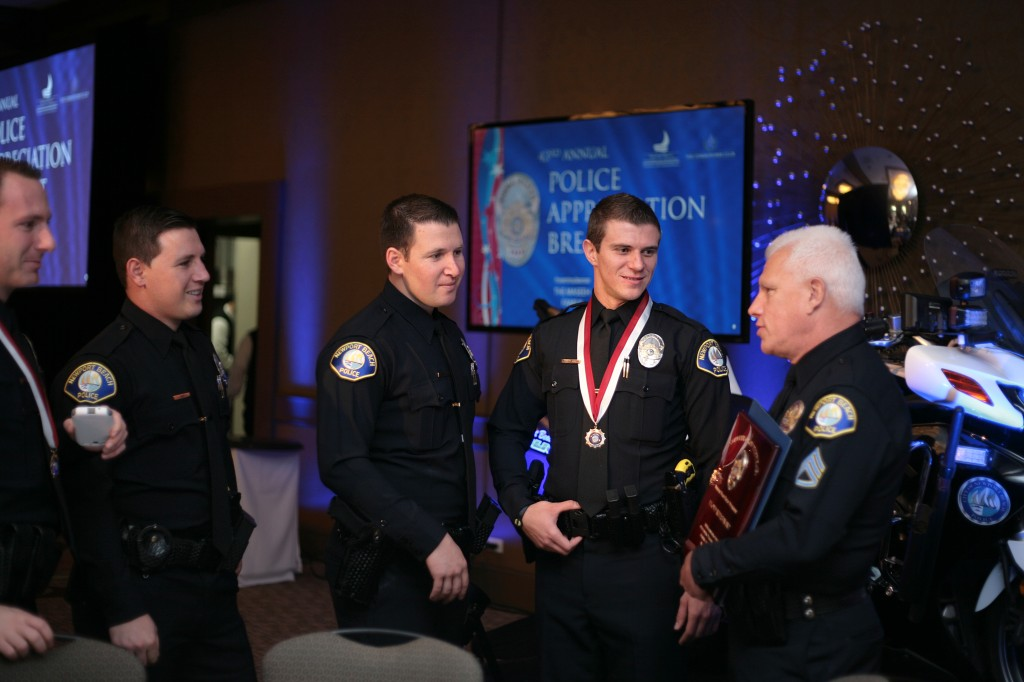 Supervisor of the Year Lloyd Whisenant (far right) talks to other NBPD officers, including Award of Merit winner, Officer Andrei Bratiloveanu (second from right) — Photo by Sara Hall