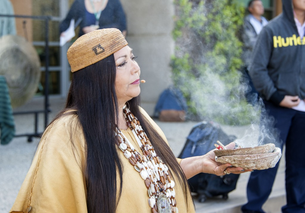 Jacque Tahuka-Nunez, from the Acjachemen Nation of the Juaneno Band of Mission Indians, burns sage as she performs a Native American blessing of the land at Sage Hill School, in conjunction with the construction of the Lisa Argyros and Family Science Center.   — Photo by Charles Weinberg