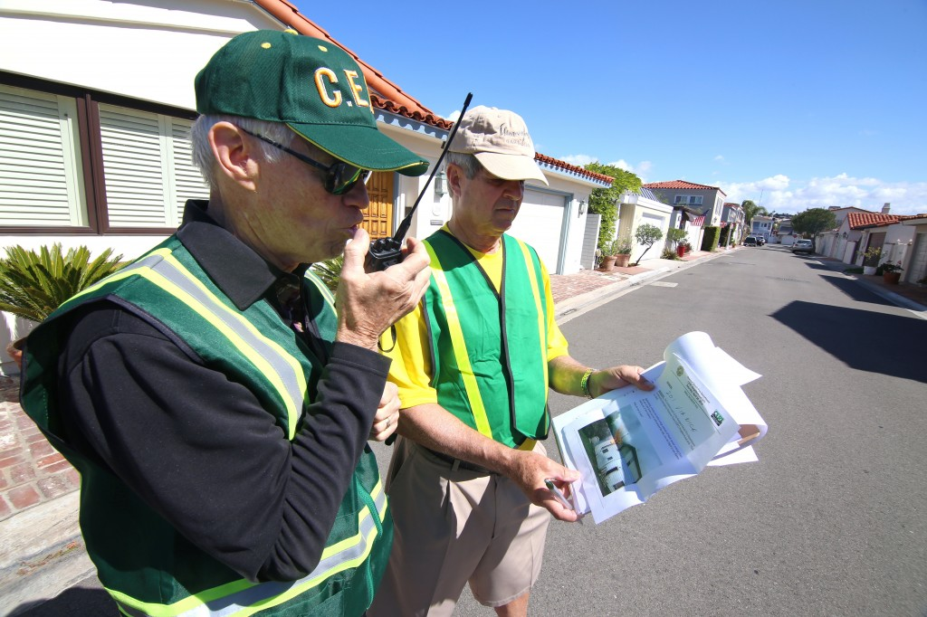 Lido Isle residents Dave Lamb (left) radios in the details of a hypothetical house fire as Hugh Helm checks the incident report during Newport Beach Fire Department's first ever Community Emergency Response Team multi-neighborhood drill on Saturday. — All photos by Jim Collins ©