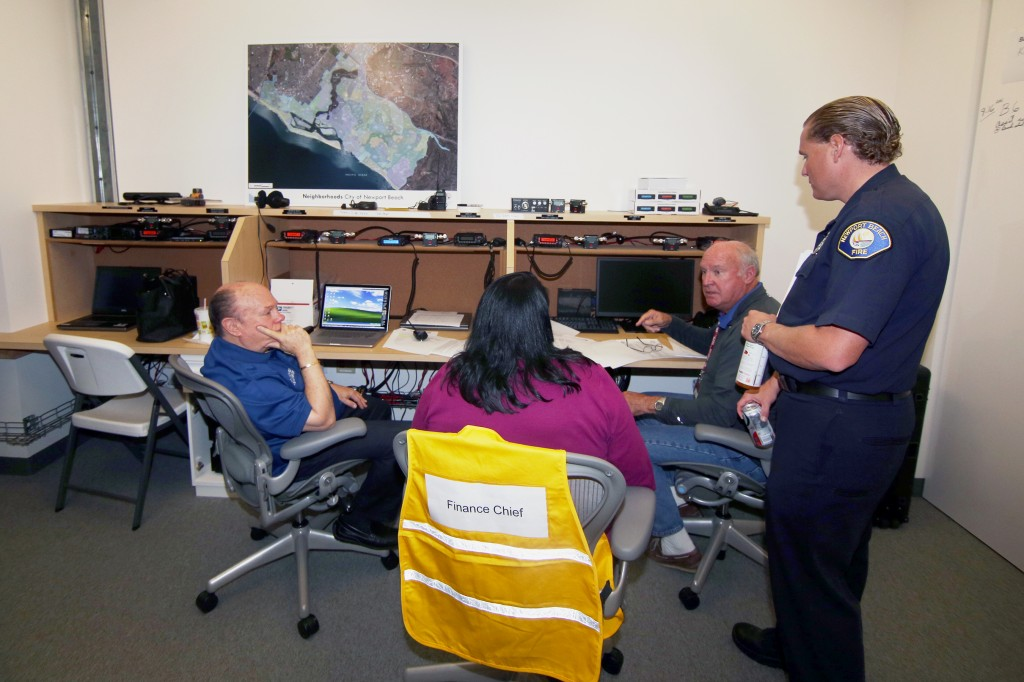 NBFD life safety specialist and CERT program leader, Matt Brisbois (right), talks with volunteers at the city's Emergency Operations Center during the drill on Saturday.