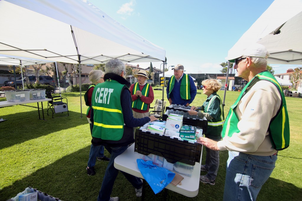 The Lido Isle CERT medical team discuss ideas during the drill.