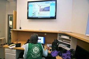 CERT volunteer Karen Tringali checks the Twitter feed for status updates in the volunteer room at the city EOC during Saturday's drill.