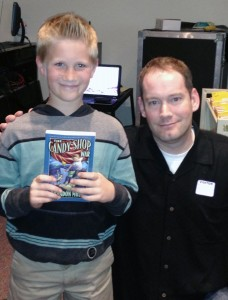 "Under Cover columnist Edie Crabtree's son, Luke Crabtree, with Brandon Mull, author of ""The Candy Shop War."""