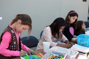 Kids create drawing to include with the sack lunches that went to Lighthouse Ministries
