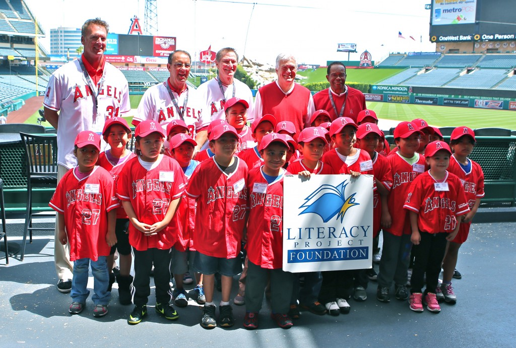 "L to R back row: Chuck Finley, Clyde Wright, Bobby Grich, Angels Baseball Chairman Dennis Kuhl, and Rod Carew pose with Anaheim school children as part of Angels Baseball Foundation's ""Readers in the Outfield"" Literacy Day to benefit Newport Beach-based Literacy Project Foundation's reading program."