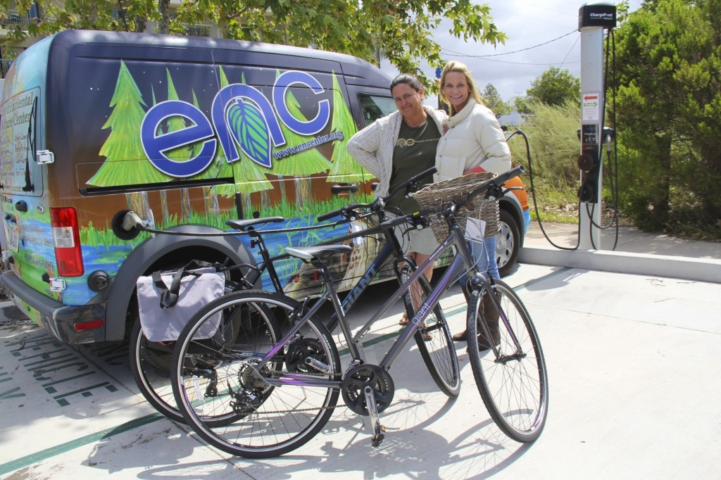 (left) Melody Robinson, a member of the Philanthropy Committee for the Newport Chapter of National Charity League, presents two donated giant escape hybrid bikes to Lori Whalen, Education & Community Relations Director of Environmental Nature Center in Newport Beach. — Photo courtesy National Charity League ©