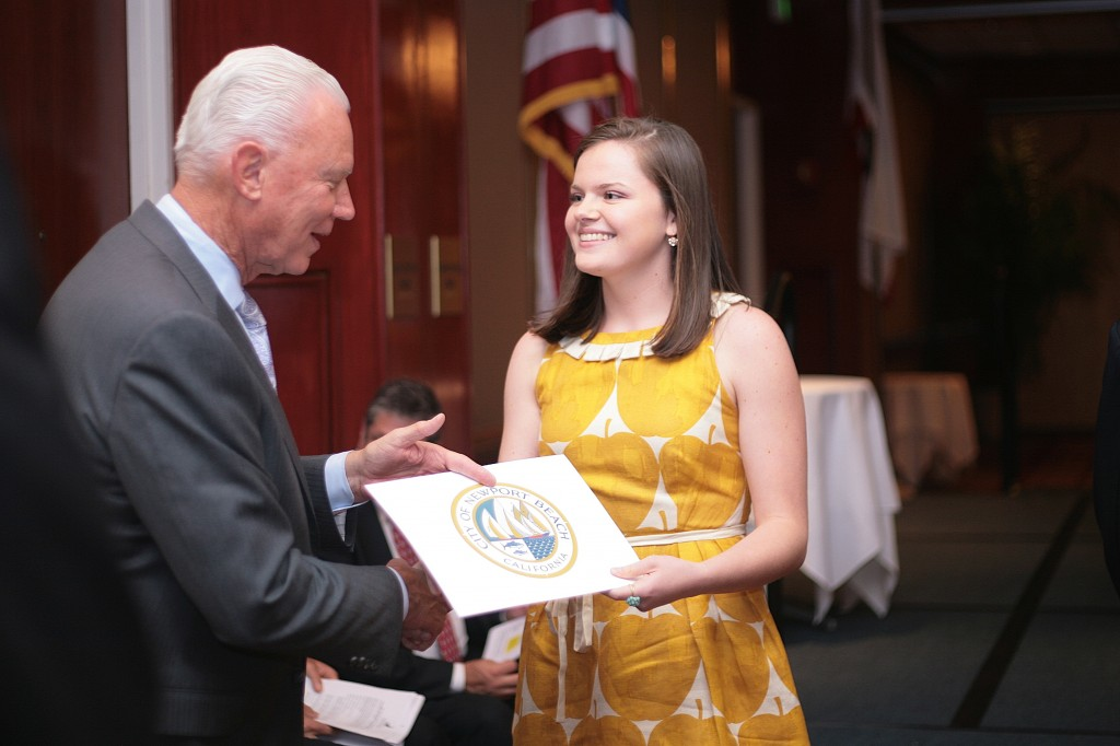Mayor Rush Hill congratulates Sage Hill School senior Erika Lynn-Green during the ceremony. Lynn-Green said her most memorable moment at Sage was  the long hours working on the student newspaper. She plans on studying molecular biology and English at Yale University. — Photo by Sara Hall