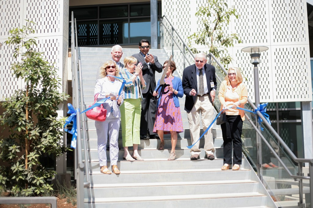Newport-Mesa Unified School District board of education members, including president Karen Yelsey (holding scissors) and district officials cut the ribbon to officially open the Corona del Mar Middle School enclave during a ceremony on Wednesday. — All photos by Sara Hall ©