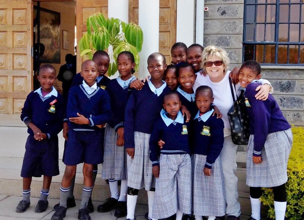Kenyan kids with Cradle to Career executive director Jene Meece.  — Photo courtesy Jene Meece ©