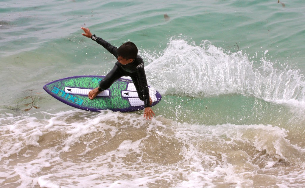 A young boy enjoys the waves at the city's skimboarding camp last year. — Photo courtesy the city of Newport Beach ©