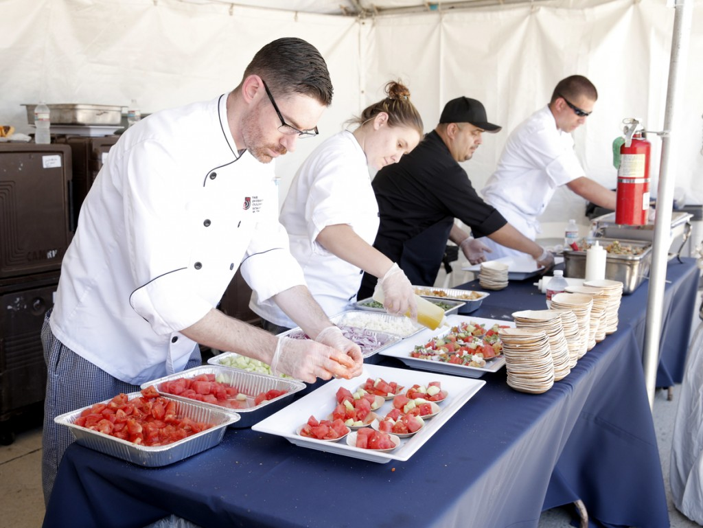 The Art Institute student chefs prepare and serve tastes of their menu
