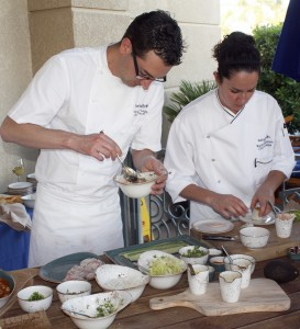 Executive Chef Vincent Lesage and Chef de Cuisine Rachel Haggstrom prepare menu samples.