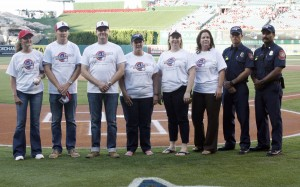 Michelle Wulfestieg (left) and Hoag staff and doctors pose for a pre-game photo at Angel's Stadium