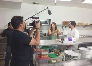 "Carrie Williams films a segment of ""Dine Newport Beach."""