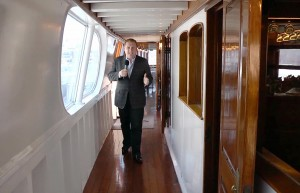 """Gary Sherwin, president & CEO of Newport Beach and Company, hosts NBTV's """"The Backstory."""" He is shown aboard the Wild Goose Hornblower yacht once owned by John Wayne."""