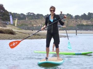 """Kelly Lam, host of NBTV's """"Active Me"""" demonstrates paddle boarding in the Upper Back Bay."""