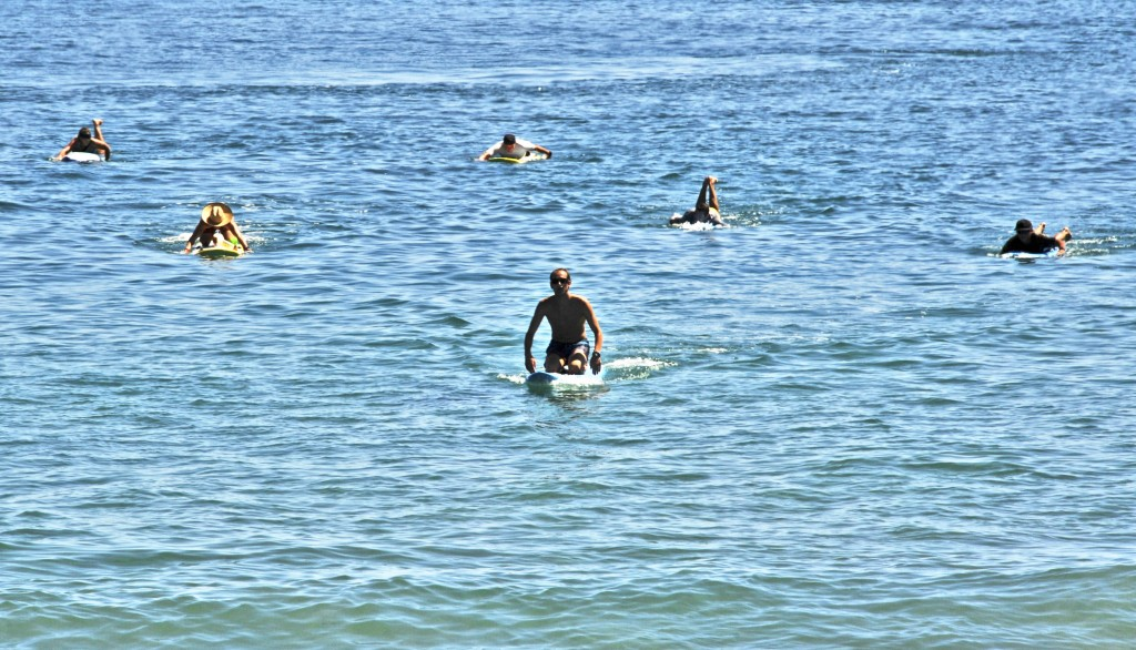 Newport Beach Lifeguards participate in relay paddle for John Wayne Cancer Foundation. — Photo by Lawrence Sherwin ©