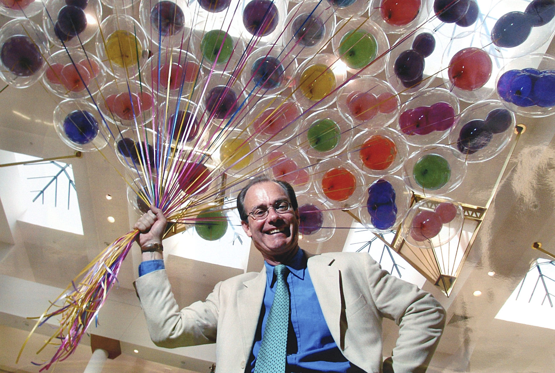 Treb Heining and a handful of colorful balloons. — Photo courtesy Treb Heining ©