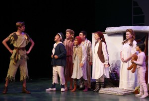 Christopher Huntley (left) as Peter Pan and the cast of Peter Pan