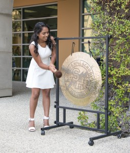 "Student body president and Sage senior Rachana ""Cha Cha"" Pillai striking the gong to kick off the new school year. — Photo by Charles Weinberg ©"