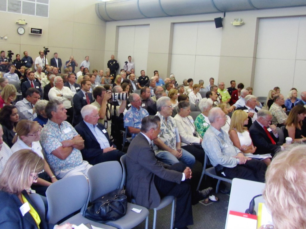 A packed house listens to the city council candidates. — Photo by Sara Hall ©