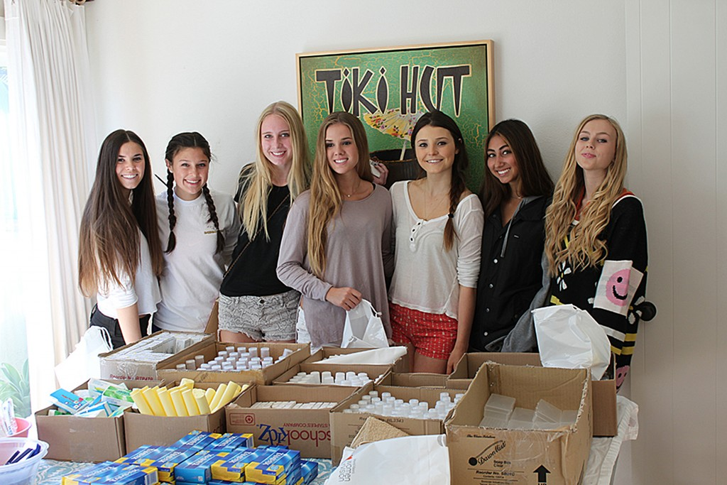 Kits 4 Kindness founder Madeline Hall and friends assemble hygiene kits. — Photo courtesy Kits 4 Kindness ©