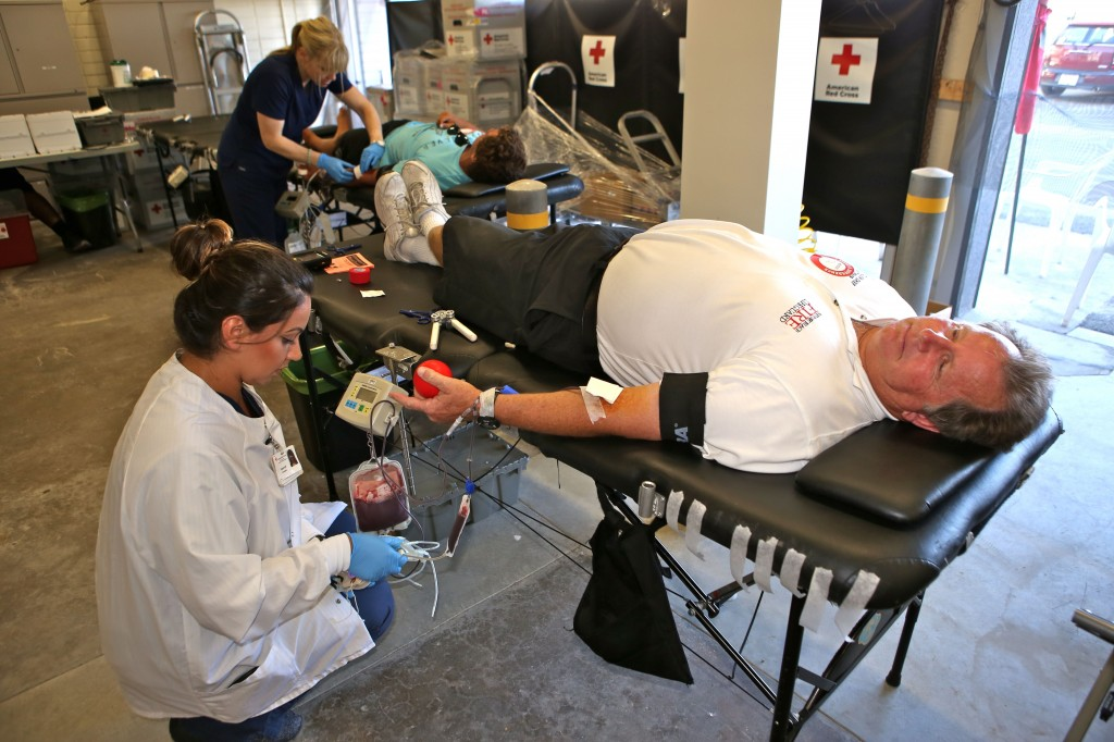 Lifeguard Battalion Chief Jim Turner gives blood during the 28th Annual Red Cross Blood Drive Wednesday at the Lifeguard Headquarters at Newport Pier.  — NB Indy Photo ©