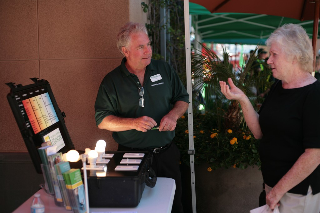 SoCal Edison representative John Fields speaks with Costa Mesa resident Kathleen Whelan about light temperature during the expo on Saturday. — Photo by Sara Hall ©
