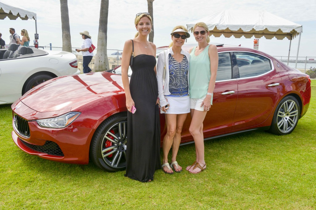 Ladies with Maserati sedan