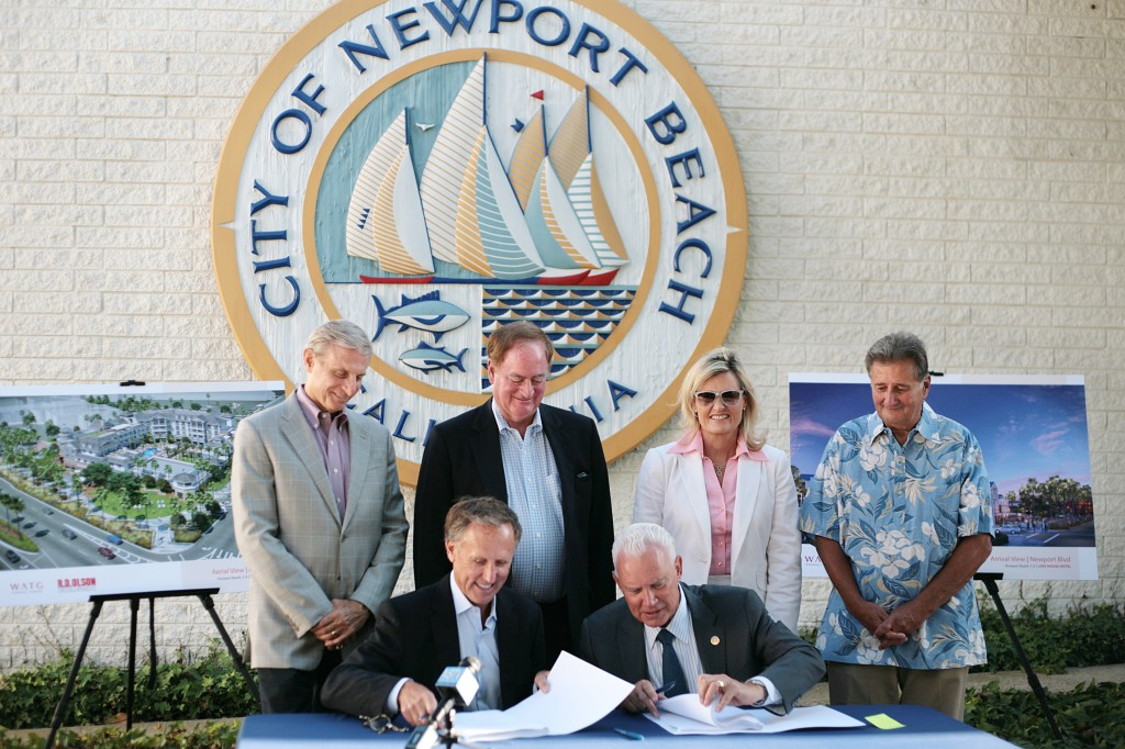 (front, left to right) Developer Bob Olson and Mayor Rush Hill sign the lease for the old city hall site as council members (back row, left to right) Mike Henn, Keith Curry, Leslie Daigle and Mayor Pro Tem Ed Selich watch. — Photo by Sara Hall ©